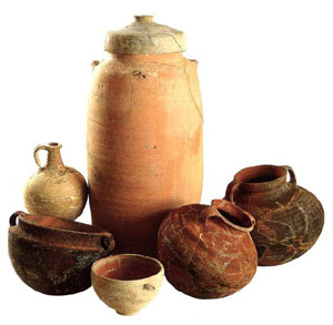 a collection of pottery