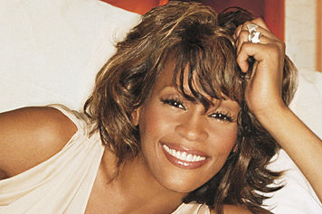Whitney Houston smiling circa 1990