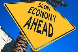 Warning sign stating Slow Economy Ahead.